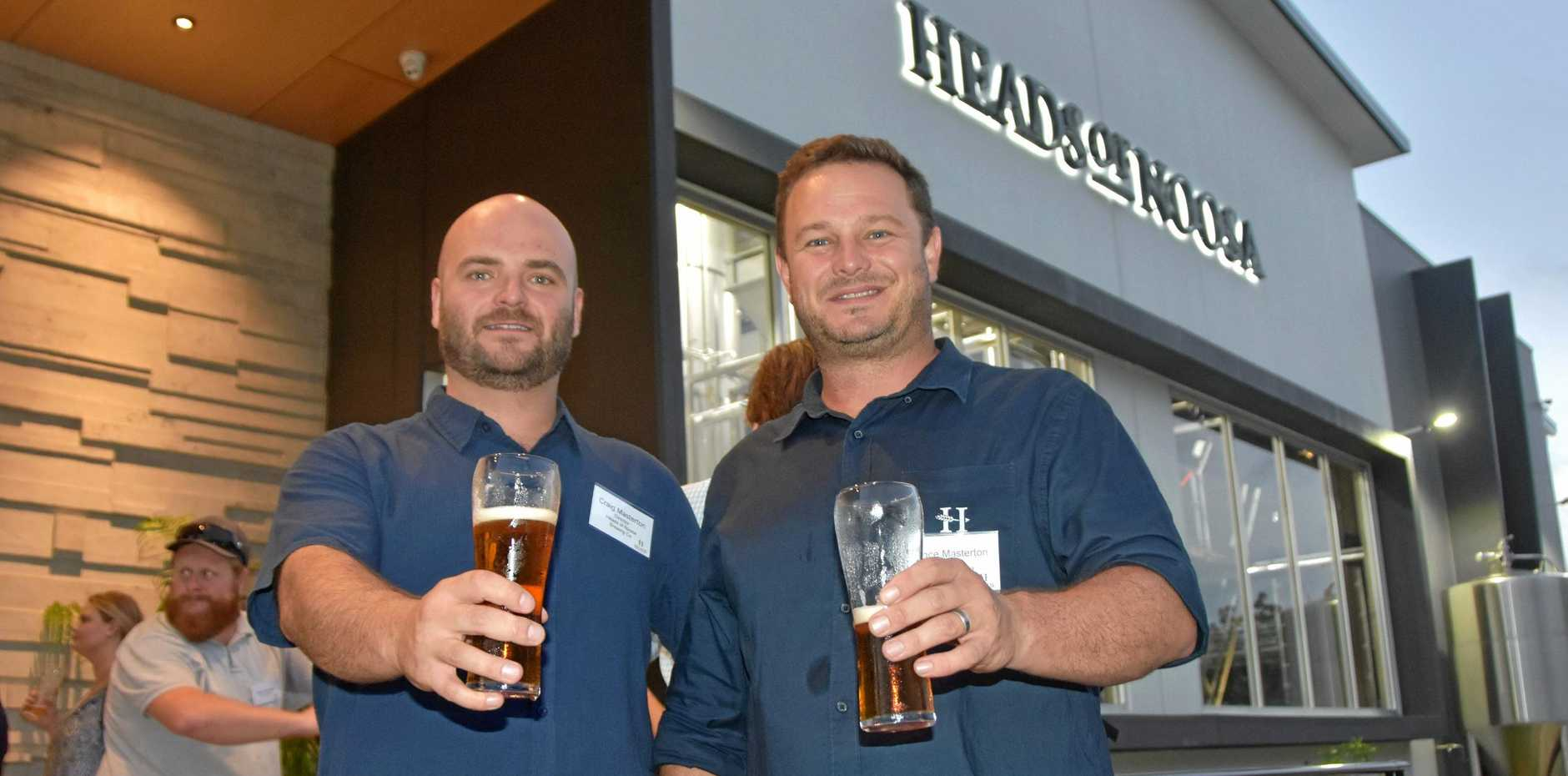 CHEERS: Heads of Noosa Brewing Company's Craig and Lance Masterton at the opening night of their brewery.