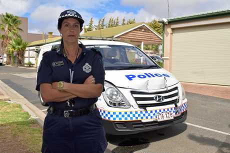 Warwick Senior Constable Tanya Binney with a van that was allegedly rammed by a Warwick man last night.