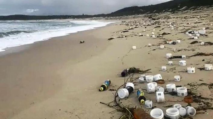 Rubbish washes up on Port Stephens beach.