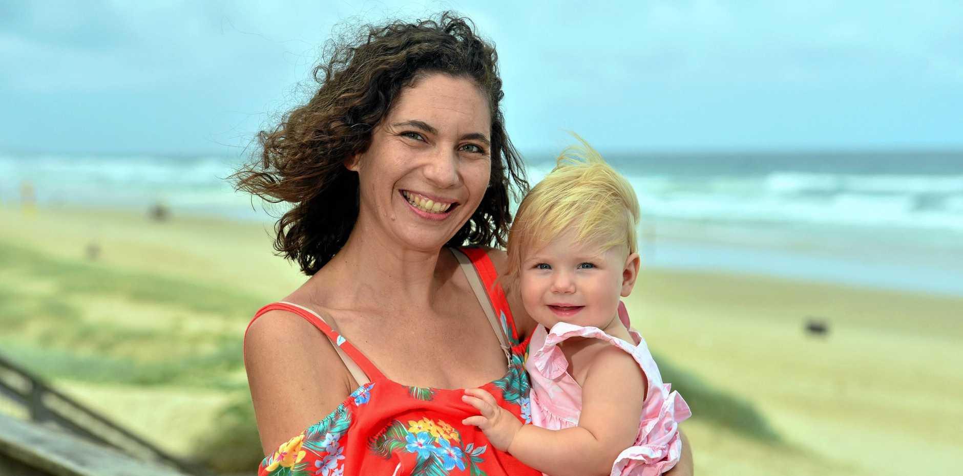 Letea Cavander with her daughter Tallulah Stuart at Coolum Beach.
