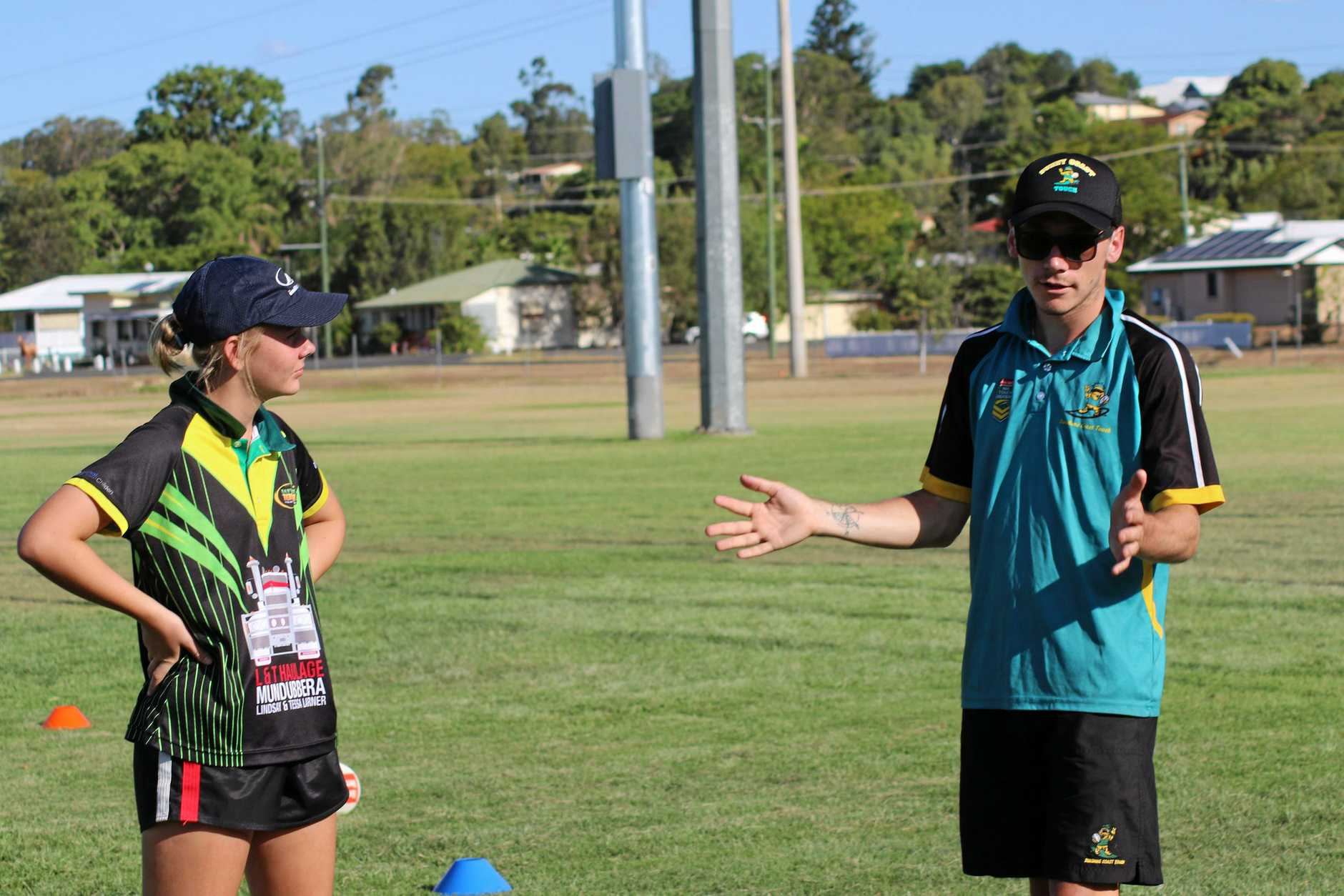 Mitch and Natalie De Rossi help Gayndah's junior touch players brush up on their skills.