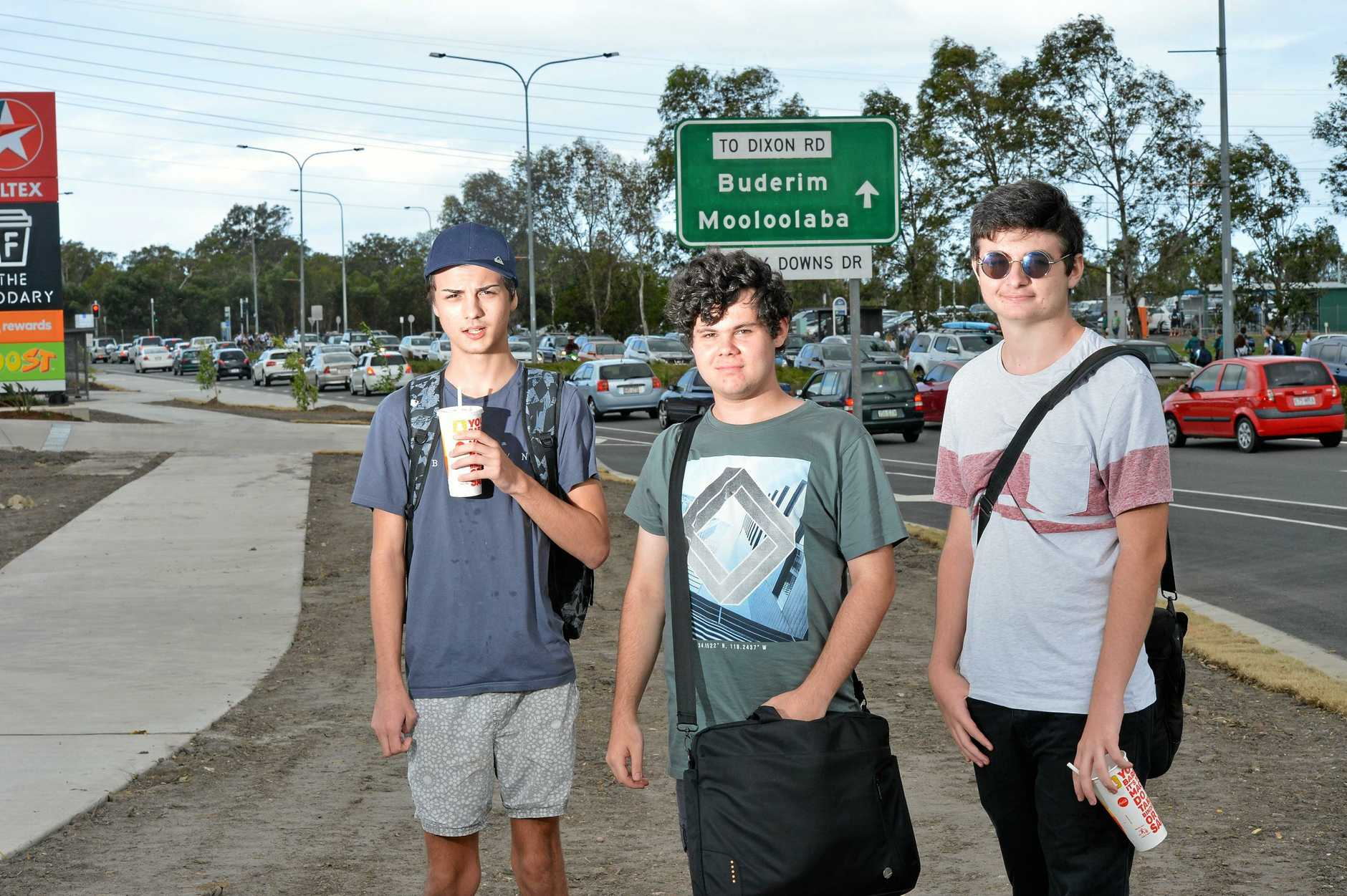 Connor Delaney (white shirt), 18, Luke Kellett (green shirt), 18, and Tyson Alker (black hat), 18, are University of the Sunshine Coast students taking advantage of the nearby food options which have drawn hundreds of schoolkids each day.