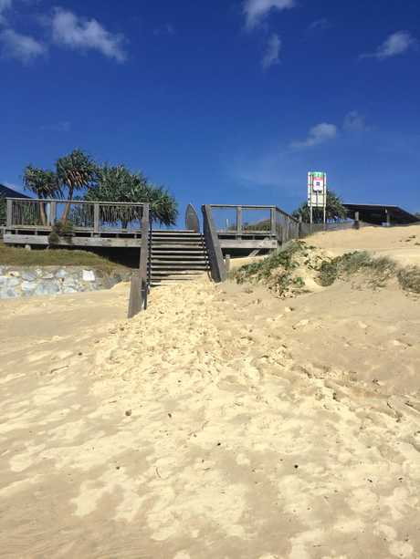 Sand covers the steps at Beach Access 77 in Coolum.