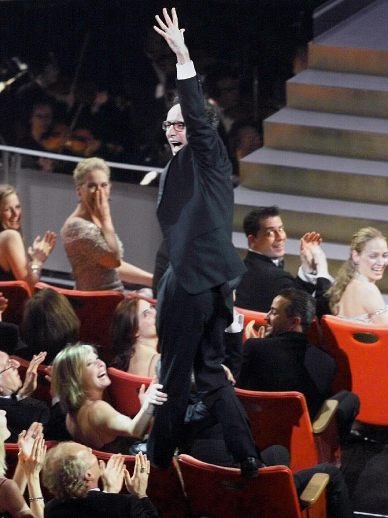 Roberto Benigni was caught jumping on the back of his seat after winning an Oscar in 1999. Picture: supplied
