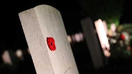 A grave lit up at the Villers-Bretonneux service. Picture: Ella Pellegrini/ News Corp Australia