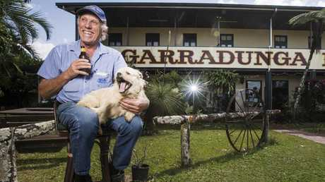 Garradunga Hotel Owner Ian 'Cambo' Campbell with his trusty dog Odie. PHOTO: LACHIE MILLARD