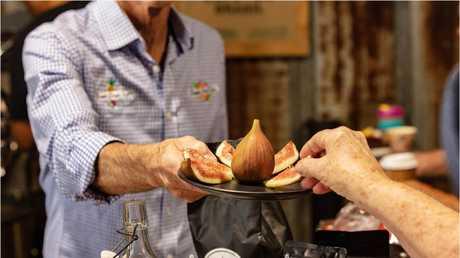 Tasting figs at Alloway Farm Market, Bundaberg
