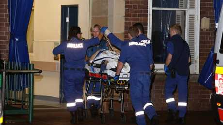 One of the victims of the shooting is taken into RPA Hospital.