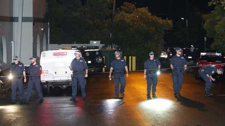Police comb the area looking for clues after the shooting in Pyrmont.