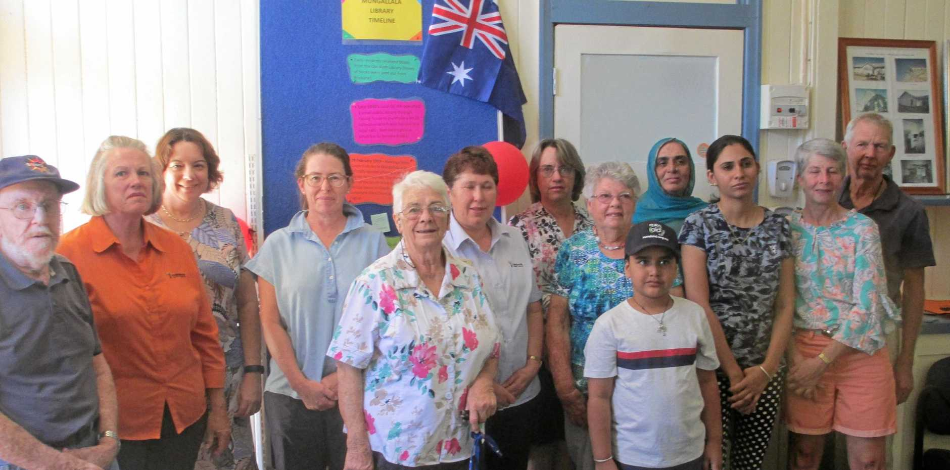 VALUED SERVICE:   Brenda Jukes (centre) surrounded by her community at the Mungallala Library.