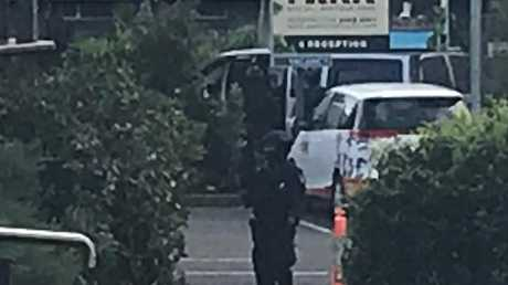 Armed police surround the property. Picture: Jane Hansen