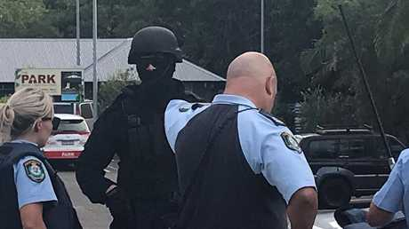 Masked police on the property today. Picture: Jane Hansen