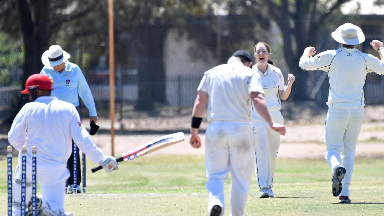 Amanda Jade Wellington takes one of her three wickets for the Port Adelaide men's D grade side on Saturday. Picture: Keryn Stevens/AAP