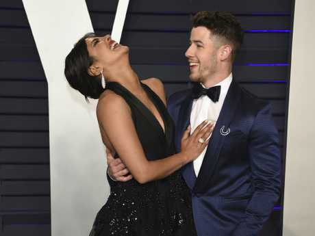 Newlyweds Priyanka Chopra, left, and Nick Jonas were loved up at the Vanity Fair party. Picture: AP