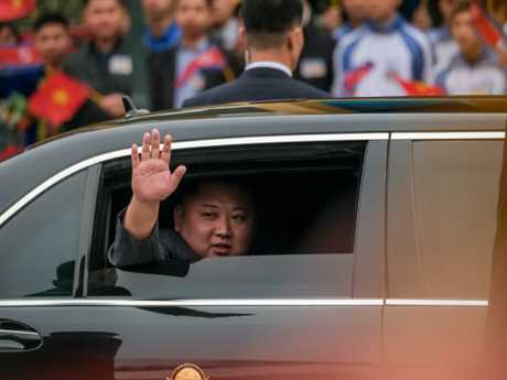 Kim Jong-un waves from his car after arriving by train at Dong Dang railway station near the border with China in Lang Son, Vietnam. Picture: Getty