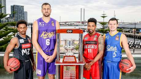 Casper Ware (Melbourne United), Andrew Bogut (Sydney Kings), Bryce Cotton (Perth Wildcats) and Jason Cadee (Brisbane Bullets) with the Dr John Raschke Trophy for the NBL champion. Picture: Tim Carrafa