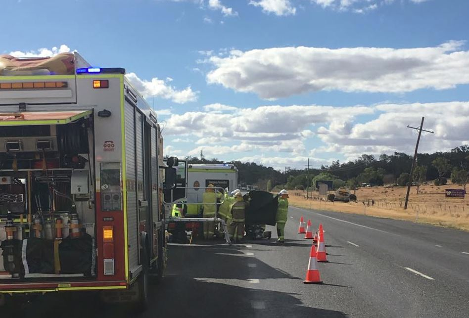 Emergency services at the scene of the incident where a Laidley Heights woman, 60, was impaled by a metal rod on the Warrego Highway east of Oakey.