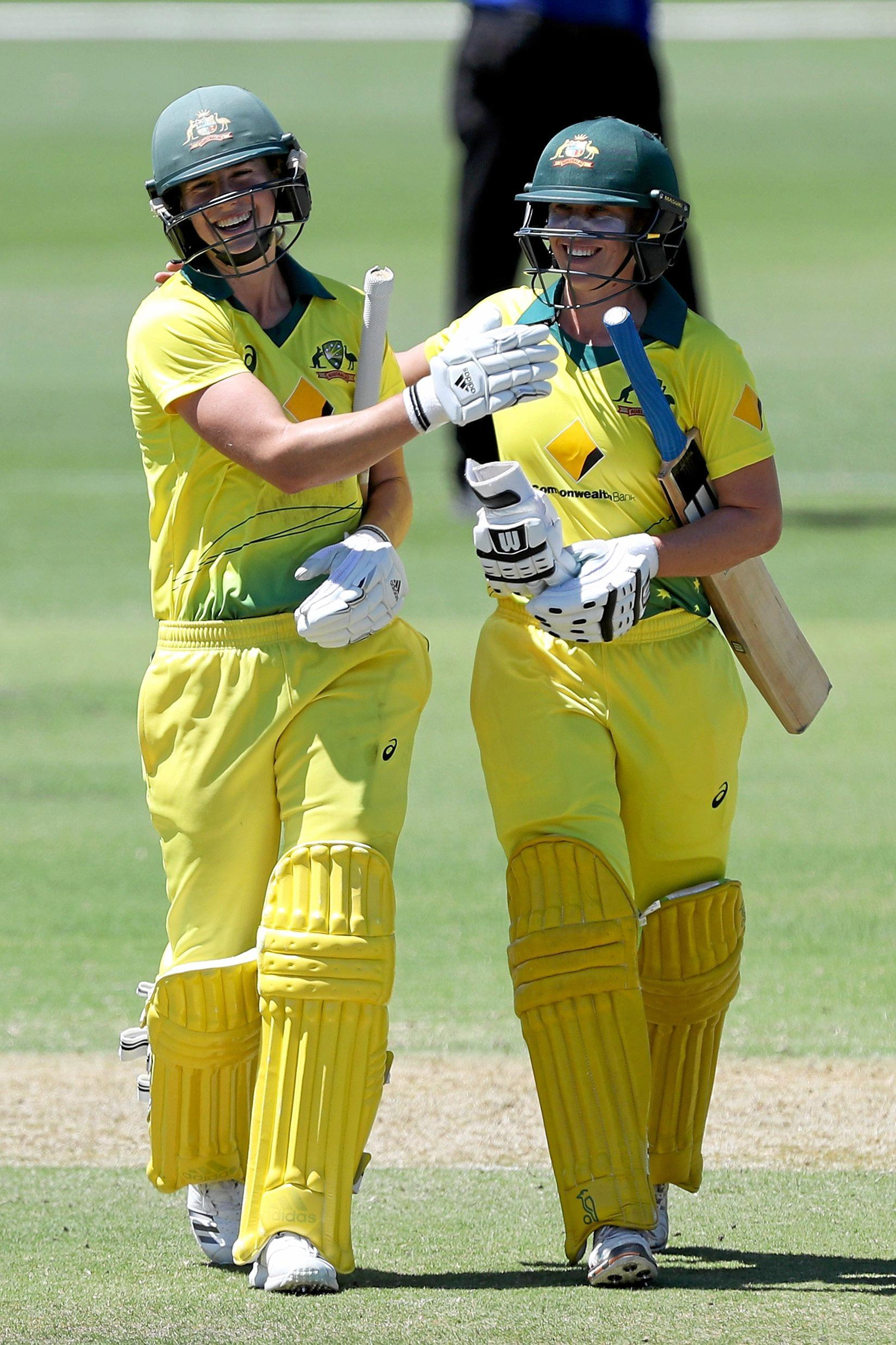 CLASS: Ellyse Perry of Australia celebrates her century with Warwick player Delissa Kimmince during the second women's One Day International (ODI) cricket match between Australia and New Zealand at Karen Rolton Oval in Adelaide on Sunday.