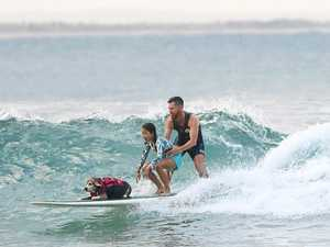 When it comes to surfing, dogs always steal the show
