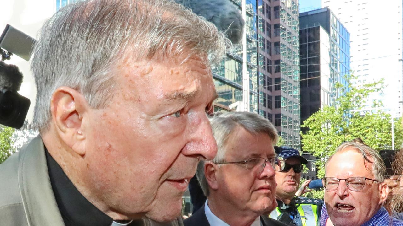 Cardinal George Pell arrives at the County Court in Melbourne to abuse from onlookers. Picture: Alex Coppel.