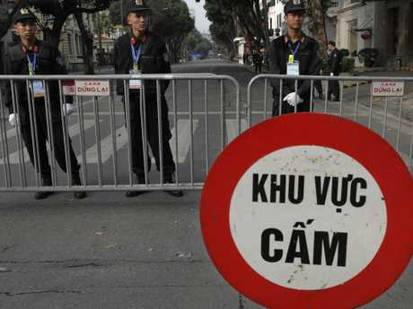 Police officers stand guard outside Metropole Hotel where U.S. President Donald Trump and North Korean leader Kim Jong-un are scheduled to have dinner in Hanoi, Vietnam. Picture: AP