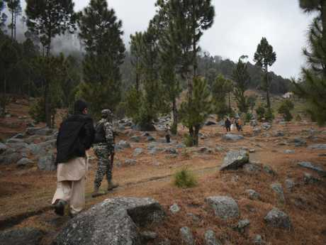 Pakistani reporters and troops visit the site of an Indian air strike in Jaba, near Balakot, Pakistan. Picture: AP