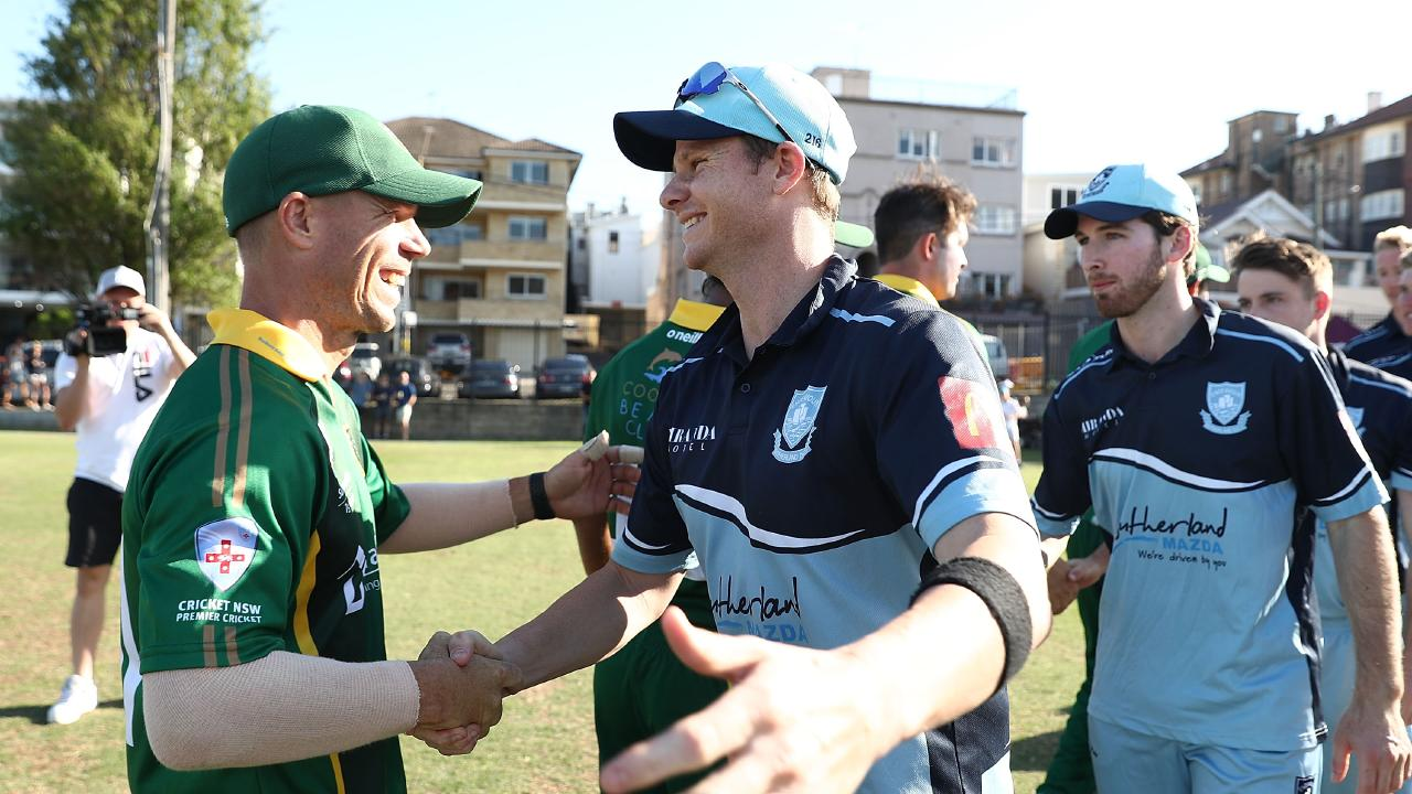 "David Warner, playing for Randwick-Petersham, shakes hands with Sutherland's Steve Smith  after a Sydney grade cricket match in November – eight months after ""Sandpaper-gate"". Picture: Mark Metcalfe/Getty Images"
