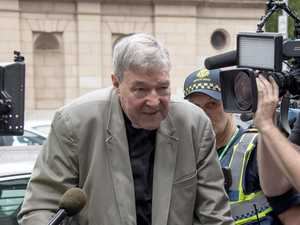 Pell's silent walk through media scrum