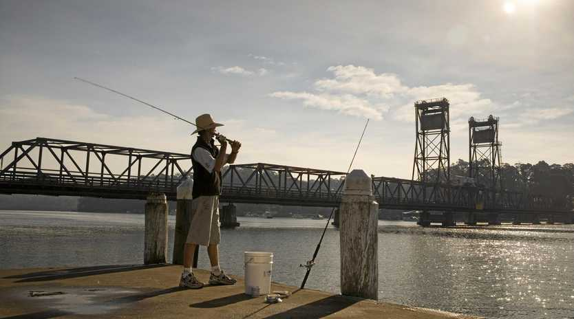 Fishing near the Princes Highway bridge at Batemans Bay, South Coast.