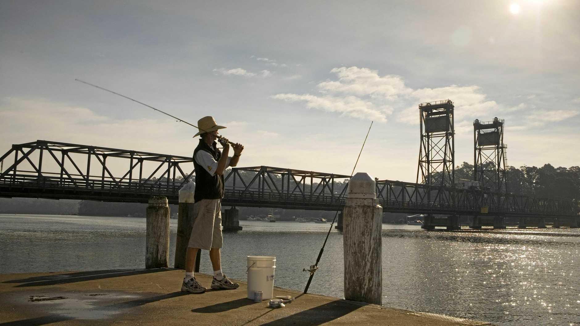 Fishing near the Princes Highway bridge at Batemans Bay, South Coast.