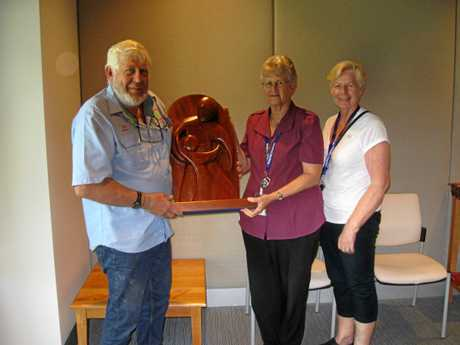 Pictured at the presentation of the Blackall Range Woodcrafters' Guild sculpture are (left to right): Immediate Past President John Muller (standing in for President Rob Otto), Chaplain Ann Shepperson and Chaplain Glady Malligan.