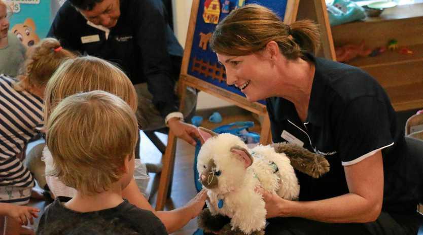 DOG PALS: Pet-friendly child care helps children establish a safe relationship with dogs.