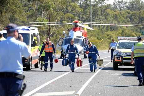 CHOPPER: Paramedics from the Westpac Life Saver Rescue Helicopter arrive at the scene of the car crash at Arrawarra on Thursday, September 7, 2017.