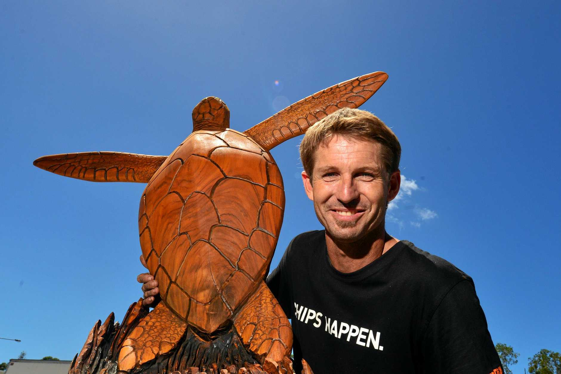 Coast sculpturer Shane Christensen uses and chainsaw and tree trunks to create pices of art.