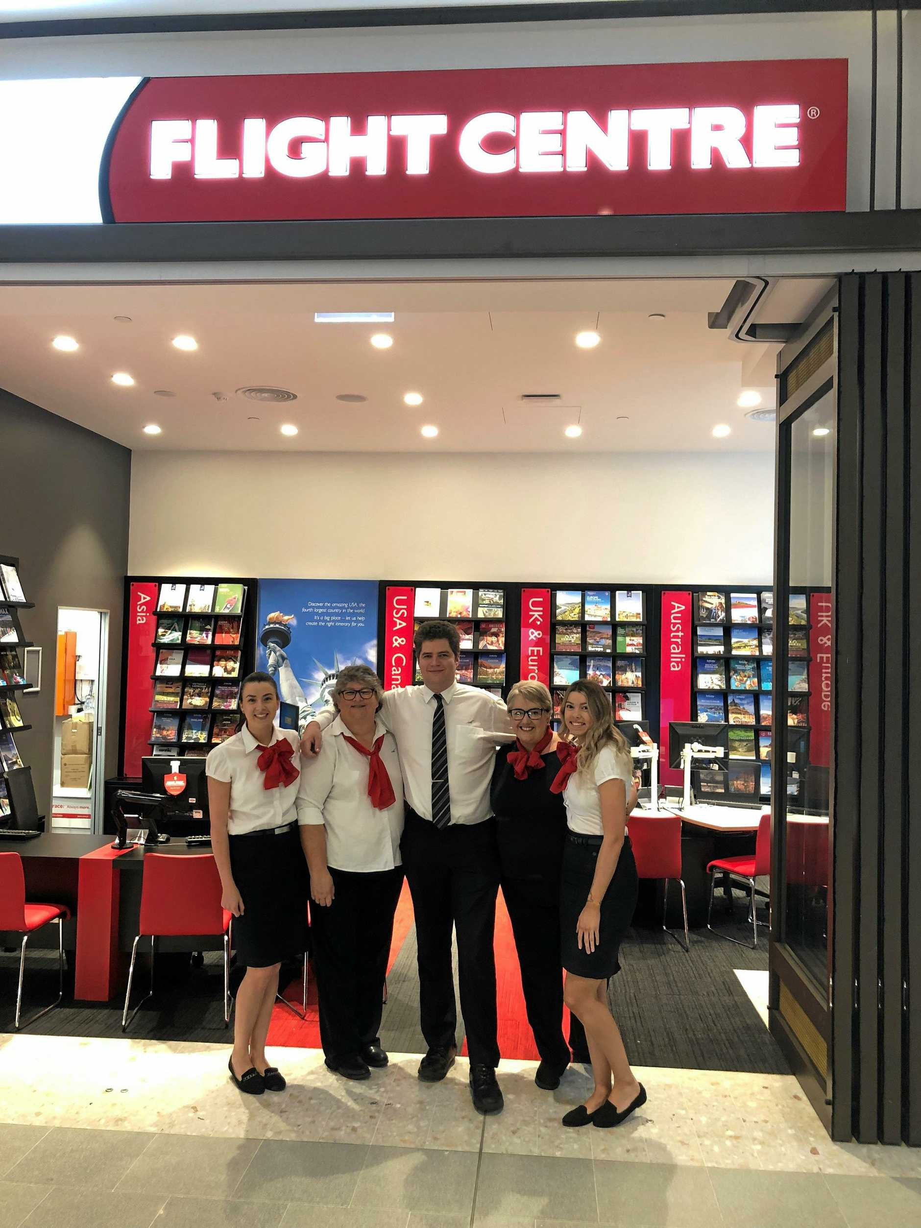 OPEN FOR BUSINESS: Excited to be opening the new Flight Centre store are (from left) Tennille Smith, Kath Grandison, James Robarts, Angela Wilkinson and Taylor Southgate.