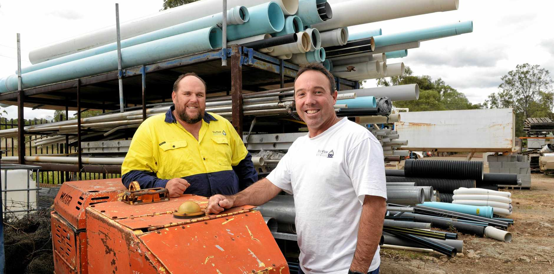 WINNERS: Dan Brassel and Matt Ostrofski from Tru-Flow Services welcomed the state's efforts to hunt dodgy builders.