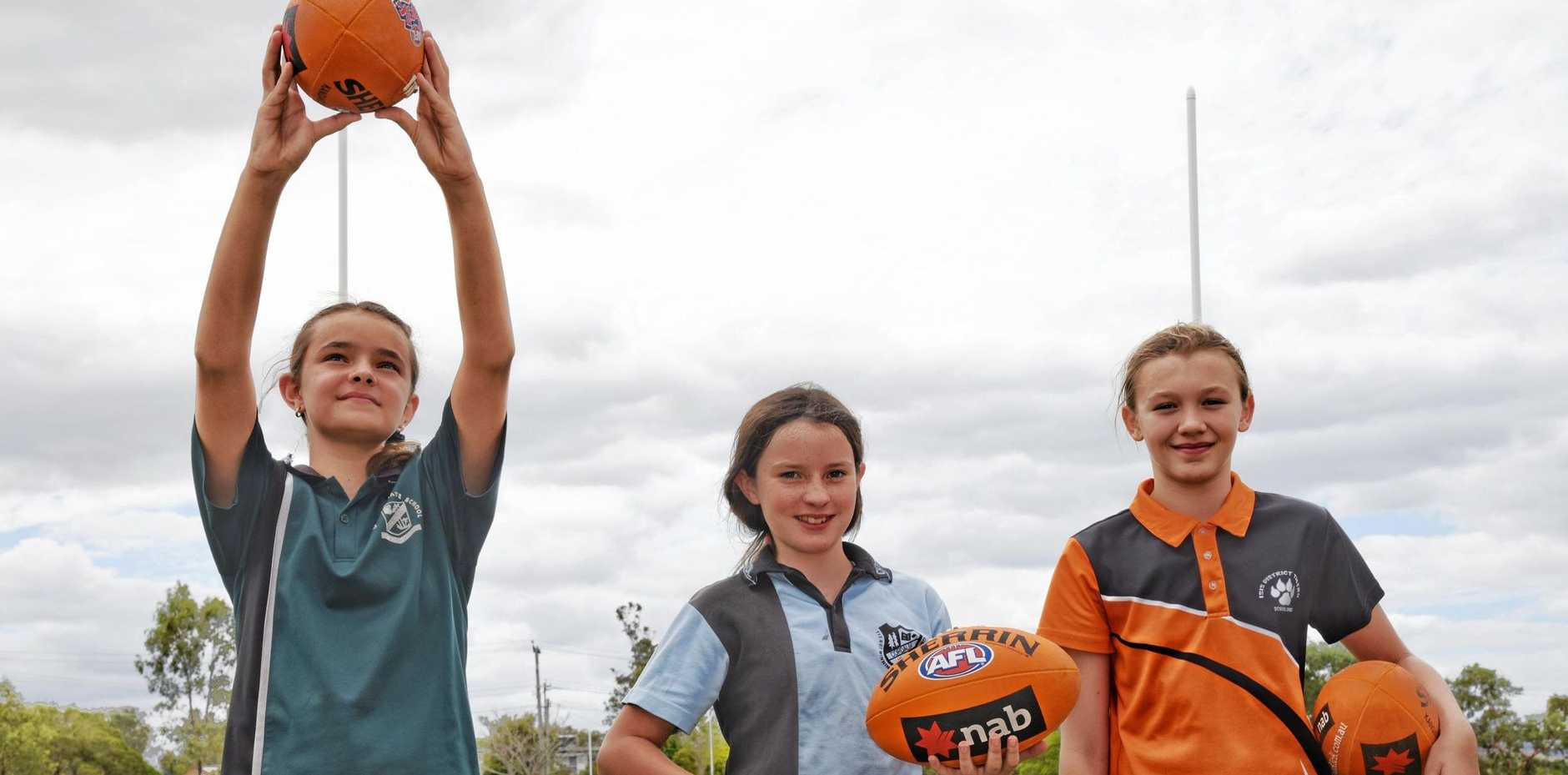 GROUNDBREAKERS: Lily Pharaoh, Lily Green and Baylie Hutton were among eight girls trialling to make the first ever North Burnett girls' Australian rules team.