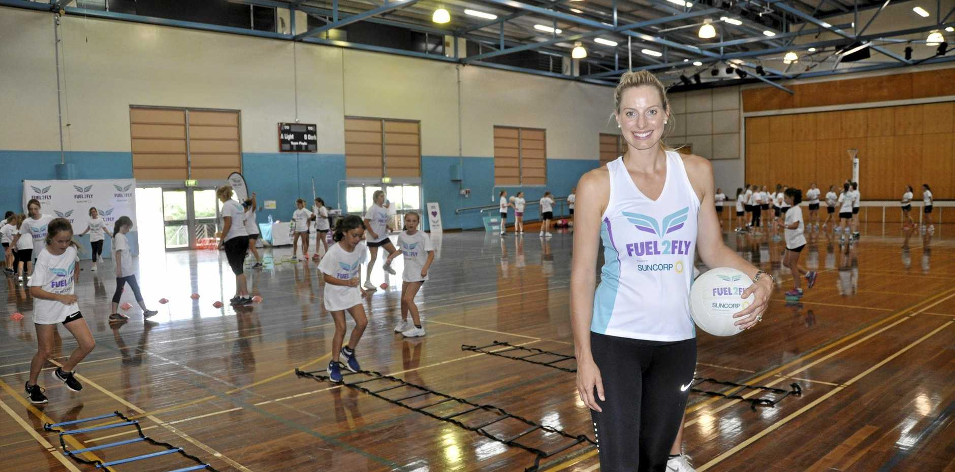 ON COURT: Former Queensland Firebirds and Australian Diamonds star Laura Geitz passed on some of her knowledge to young netballers during the Fuel2Fly netball clinic conducted at St Ursula's College earlier this week.