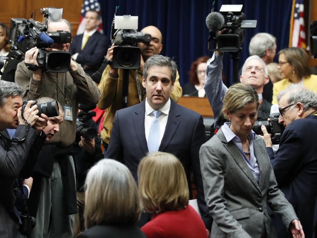 Cohen, pictured arriving to testify on Wednesday, says Mr Trump is a 'racist', a 'conman' and a 'cheat'. Picture: AP Photo/Alex Brandon