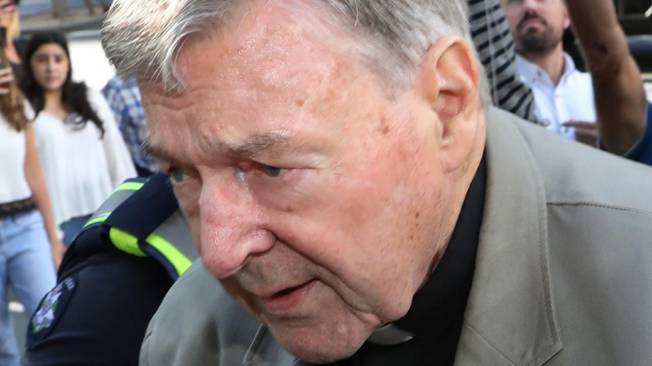 Cardinal George Pell arrives at County Court in Melbourne on Wednesday. Picture: David Crosling/AAP