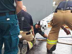 Man trapped after five-metre fall