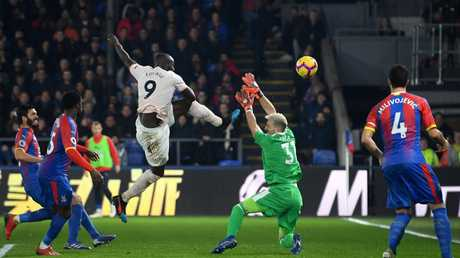 Romelu Lukaku of Manchester United scores his team's second goal past Vicente Guaita of Crystal Palace (Photo by Mike Hewitt/Getty Images)