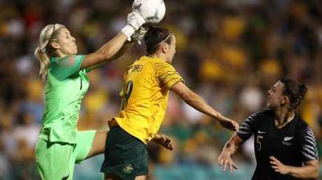 The Kiwi defence barely keep Caitlin Foord at bay.