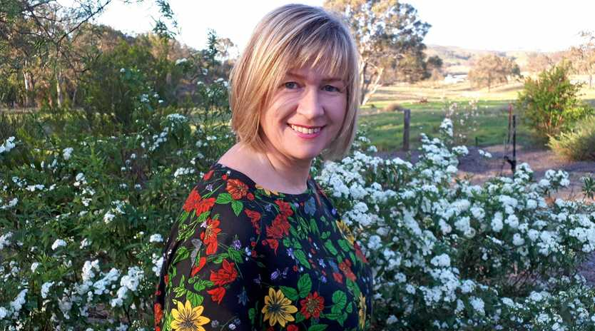 AT HOME: Dr Rachael Wallis said our identities are shaped by our environment, and our choices are heavily influenced by media, such as this image of herself at home in a pretty Toowoomba country setting.