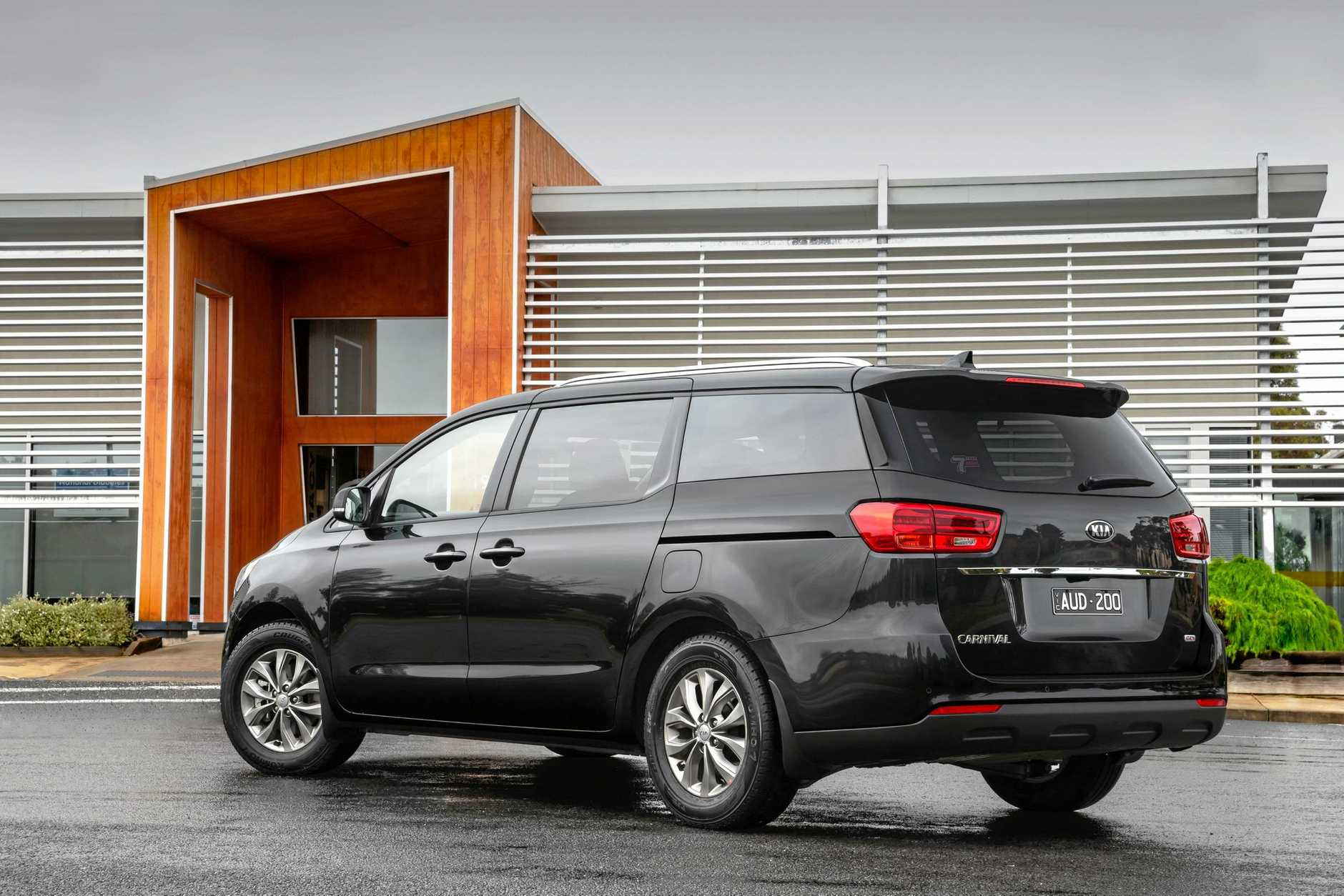 SAFE TRAVELS: The Kia Carnival handled four bags and an adult-size bike, which could be stood up without removing a wheel. Dropping the third row of seats to leave a flat load space (right) just means pulling straps and levers.