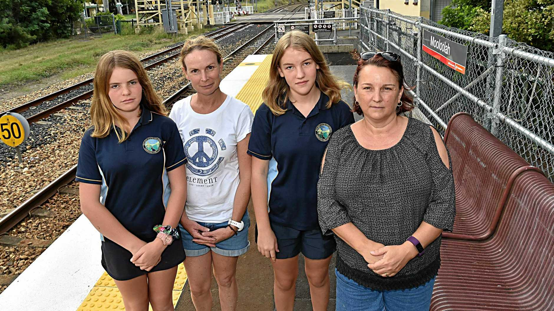 Mooloolah families struggling to send children on trains and buses to school in Maleny without financial assistance. Anna-Grace Scott, Rikki-Lee Scott, Caitlyn West and Lisa West at the Mooloolah Train Station.