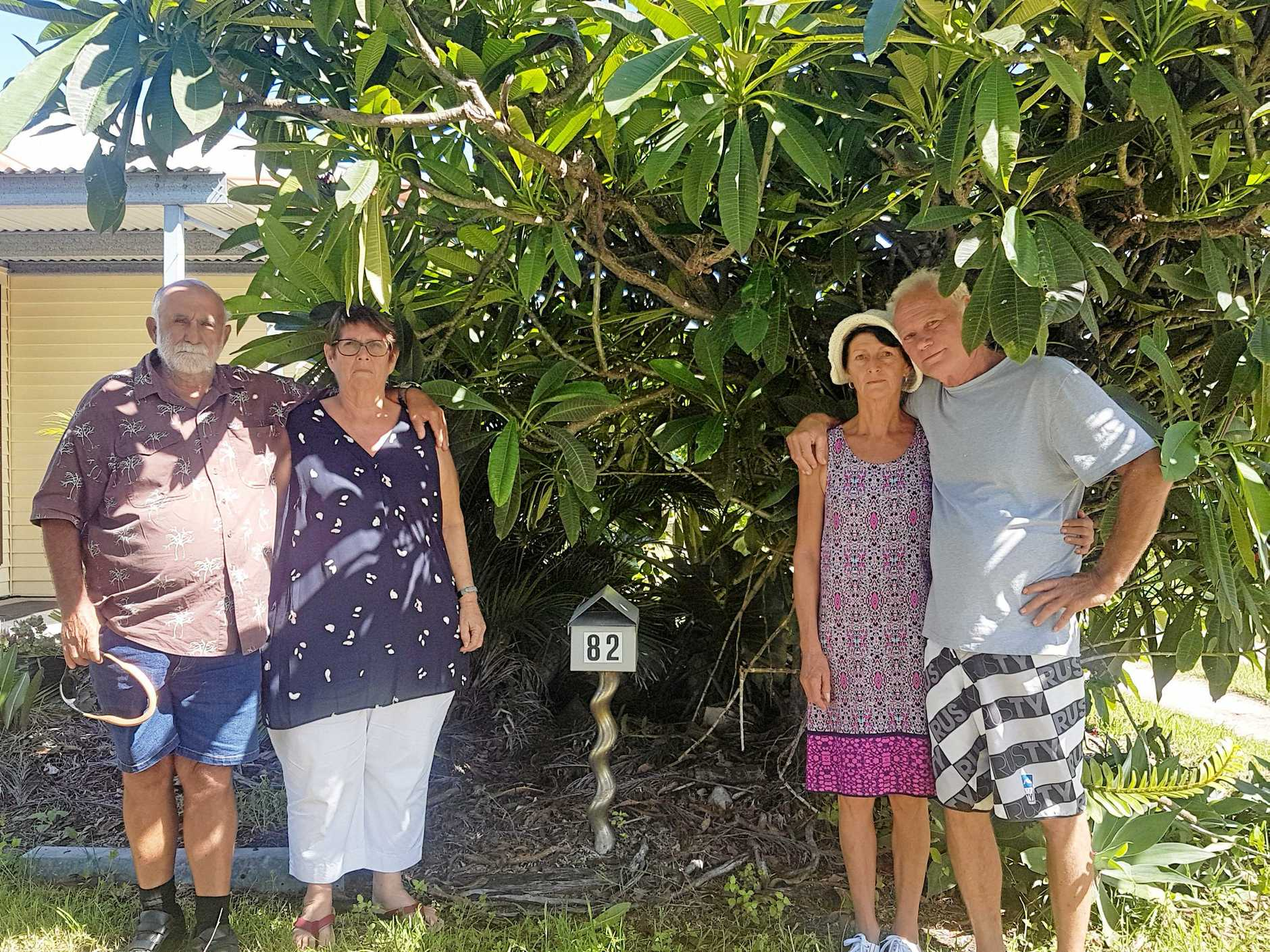 TRADING PLACES: Two sets of Bowen neighbours are facing an uphill battle in legal fees to swap land titles after realising they are living in each others home. Pictured are next door neighbours Eddie Jones, Lyn Jones, Karen Ford and Jeff Ford.