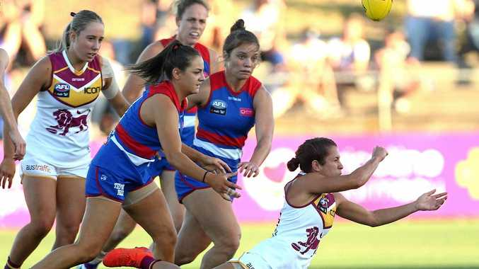 Ally Anderson handpasses during the round four match between the Western Bulldogs and the Brisbane Lions at Whitten Oval, Melbourne on February 23. Picture: Hamish Blair/AAP