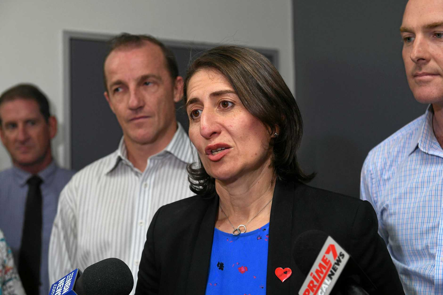 MEETING: NSW premier Gladys Berejiklian meets with Lismore mayor Isaac Smith and National's candidate for Lismore, Austin Curtin, as well as being harassed by protesters in Koala suites at the press conference site.