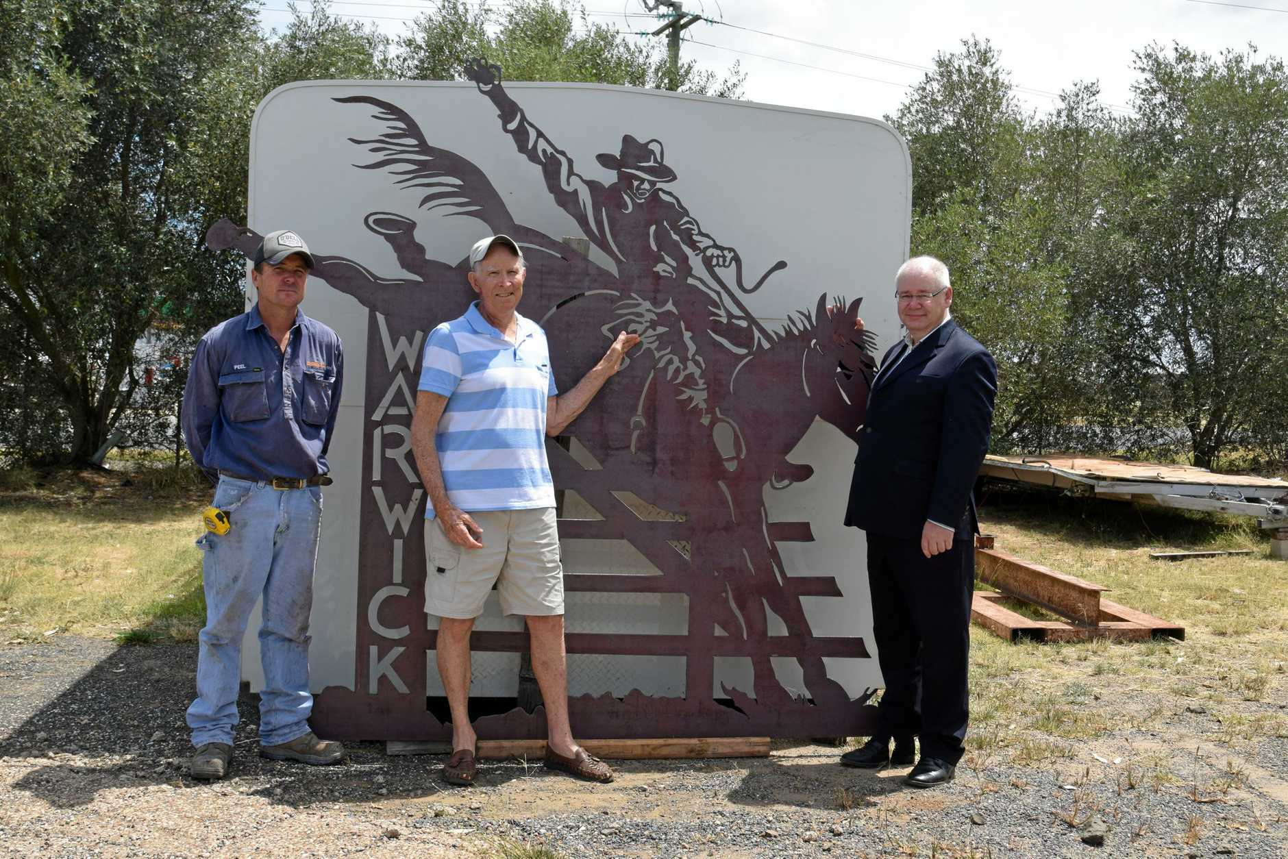 John Simpson (centre) with Condamine Steel and Rural owner Peel Tribe and Warwick Credit Union CEO Lewis von Stieglitz with a piece of the equine artwork.